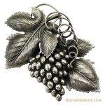 The Danish grape leaf brooch designed by Eugene Bertolli.
